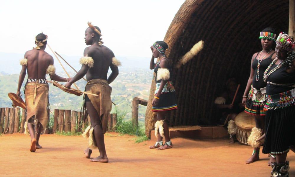 sud africa event planet group incentive travel uomini con costumi tradizionali africani